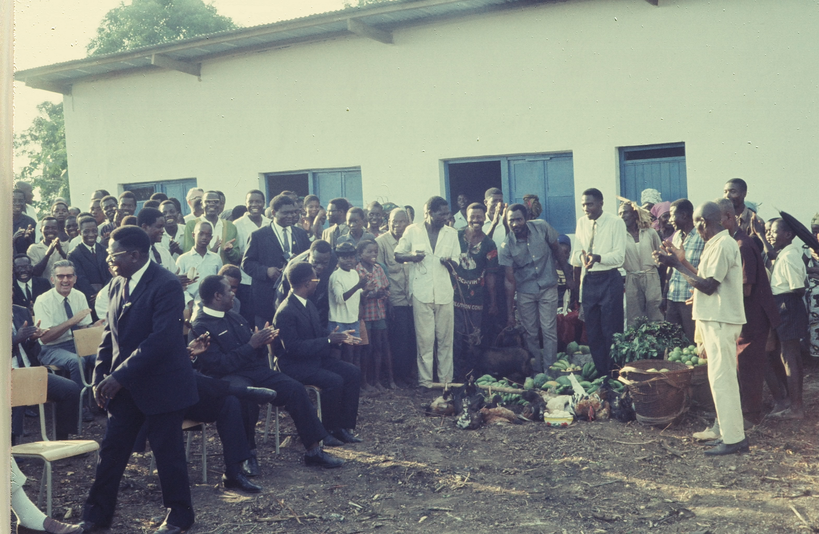 Eqeuateur Province's Governor walks back to his seat after amusing the villagers who have offered him gifts on the occasion.  Leaders of the Province's Protestant denominations of the united Church of Christ of Congo also participated in the dedication