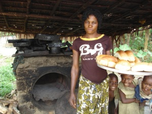 Paying her children's primary school fees is made possible by her bread sales at the Ikengo Saturday Market