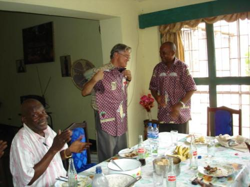 Rev. Bonanga Presents the Congo Disciples' Shirt to Doug Smith at a Farewell Luncheon in the Bonanga Home