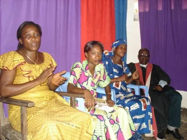 Mme. Ingesu LIKOMBA in yellow Disciples women's movement garb