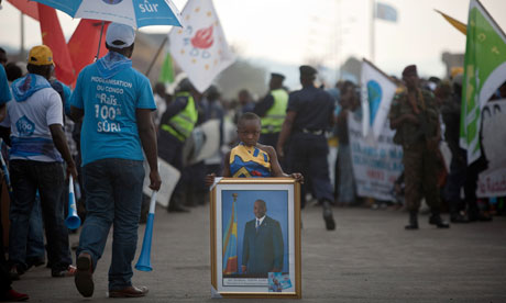 A child in South Kivu holds a photo of Pres. Kabila