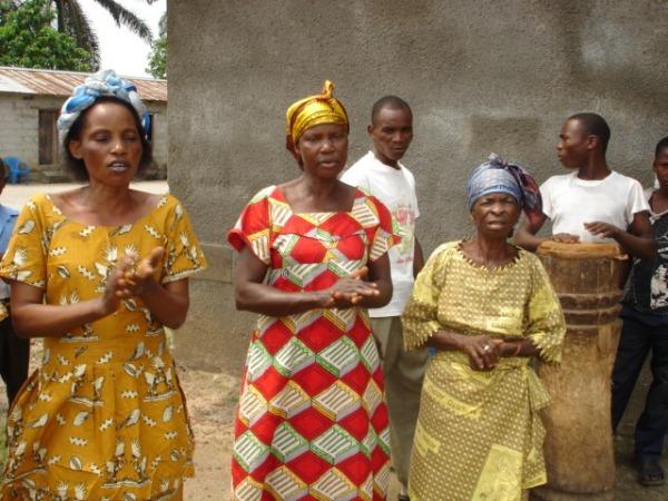On left pastor's wife Mama Micheline Mwani leads Microcredit Union at Besenge parish in Mbandaka