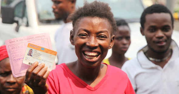 A Kinshasa Voter Holds Official Voter''s I.D. Card