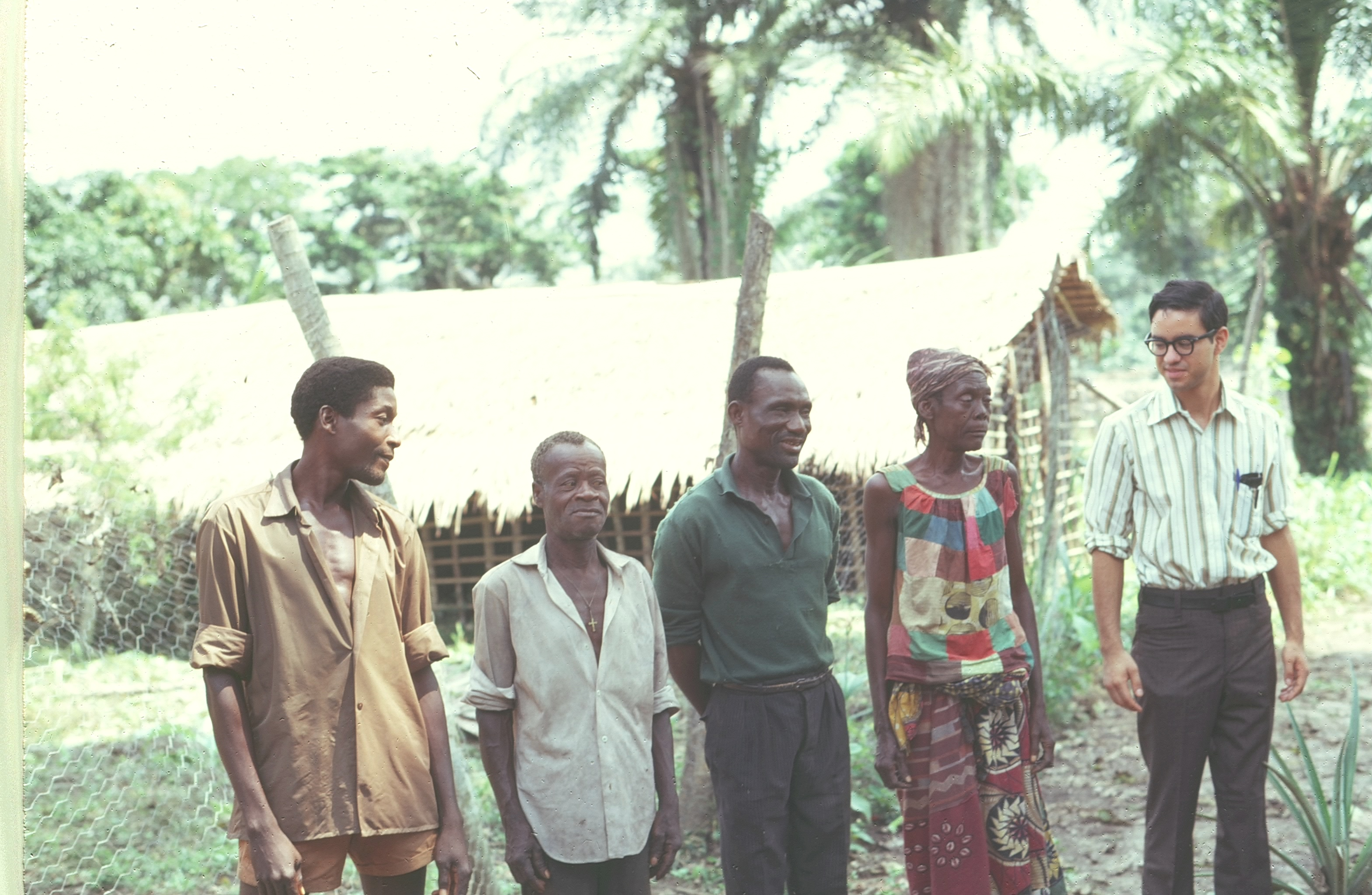 1970 Ikengo villagers with a skinny 23 year old Doug Smith in front of the chicken coop at Disciples' Agricultural Center