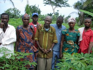2010 Ikengo villagers in the Disciples parish manioc field. Pastor Luc is third from right.