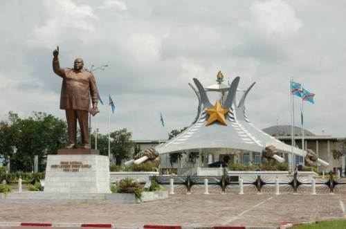Laurent Kabila statue and mausoleum with Palais de la Nation in the background