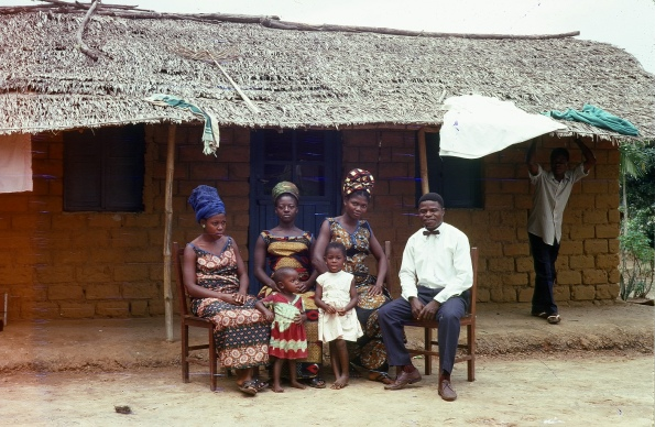 Newly married Thomas with wife Eyenga and sisters after lunching in their home June 1969