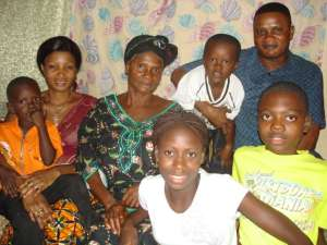 Dr. Eric, wife Nicole and children with Grandmother Eyenga Bekana