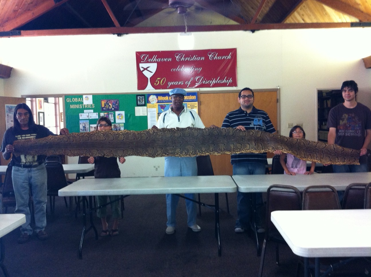 Members of my home congregation get up close and personal with the python skin