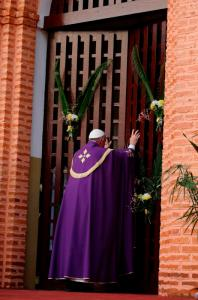 Pope Francis opens the Holy Door prior to declaring the Holy Jubilee Year of Mercy  at the cathedral in Bangui, Central African Republic, Nov. 29. (CNS photo/Paul Haring)