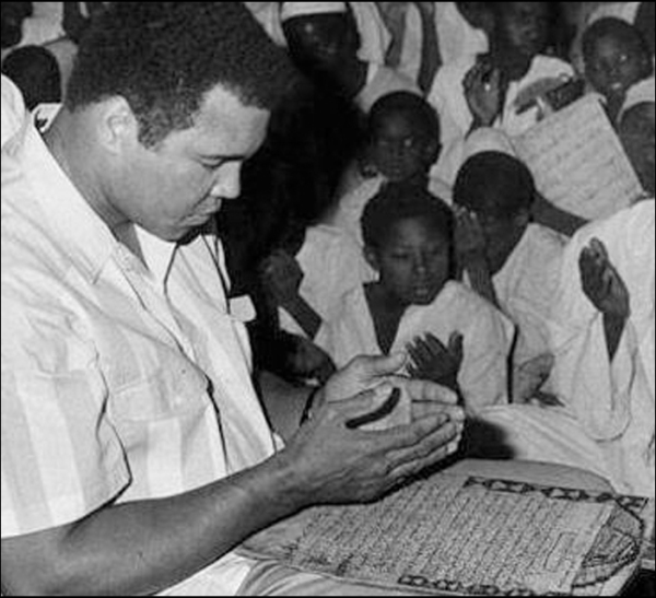 Ali praying over The Koran in an African mosque
