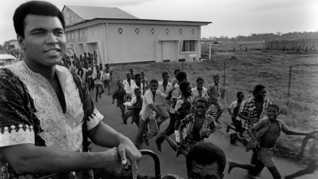 Muhammed Ali on the way from Kinshasa to his Nsele training camp 1974