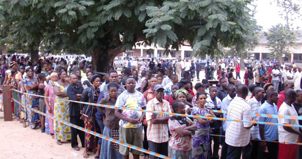 Lines of voters waiting to cast ballots in  the DRC's 2011 Presidential election